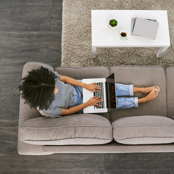 woman-typing-on-computer-on-couch